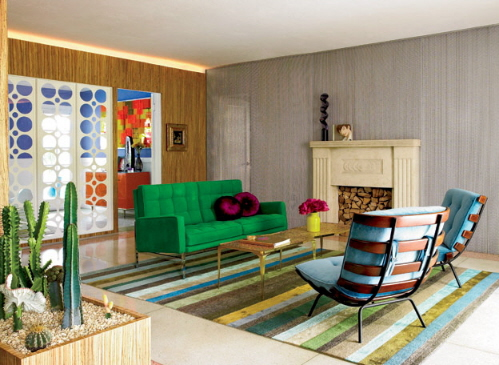 Color-living-room-with-green-solfa-,-blue-chairs-fireplace-and-small-table