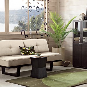 Withe-small-sofa-with-small-tables-,-cabinet-and-green-carpet