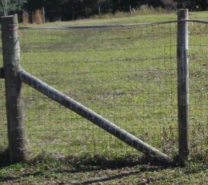 Reinforcing wooden fence posts