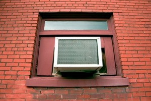 Steps to install a window air conditioner in a vertical sliding window