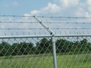 Crossing a barbed wire fence