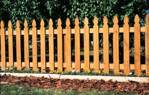 Putting up a wood picket fence